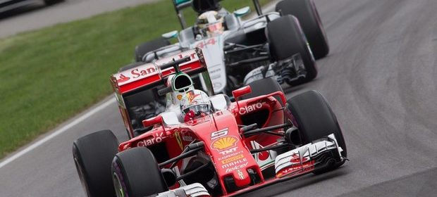 WCENTER 0XQGBCUICH                epa05359978 German Formula One driver Sebastian Vettel of Scuderia Ferrari (front) and British Formula One driver Lewis Hamilton of Mercedes AMG GP in action during the 2016 Formula One Grand Prix of Canada at the Gilles Villeneuve circuit in Montreal, Canada, 12 June 2016.  EPA/VALDRIN XHEMAJ